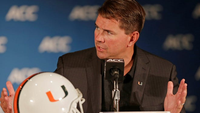 Miami coach Al Golden speaks to the media at a news conference during the Atlantic Coast Conference college football media day on July 22.