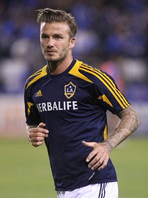 In a file photo from Nov. 7, 2012, Los Angeles Galaxy midfielder David Beckham (23) warms up before the game against the San Jose Earthquakes at Buck Shaw Stadium.