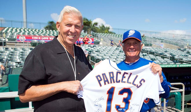 Mar 10, 2013; St. Louis, MO, USA;  New York Last March, New York Mets manager Terry Collins presented former NFL coach Bill Parcells a jersey commemorating his being inducted into the 2013 class of the Pro Football Hall of Fame.