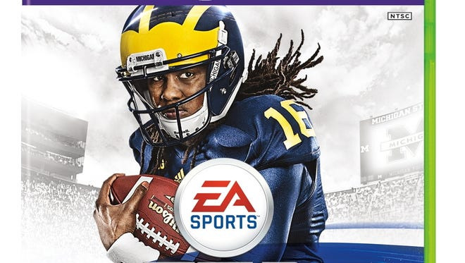 EA sports, which makes video games featuring college teams, has asked a judge to release it from a lawsuit filed by former college athletes. The suit does not involve players such as Denard Robinson, who was compensated for being featured on the game's 2014 cover after he had graduated from the University of Michigan.