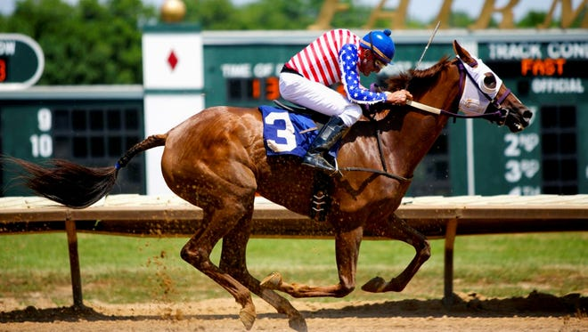 """Jockey R.A. """"Cowboy"""" Jones, 70, aboard My Kentucky Breeze, heads down the home stretch at Fairmount Park in Collinsville, Ill., on his way to a second place finish. Illinois state racing officials are investigating whether jockeys conspired to throw the race to let Jones win."""