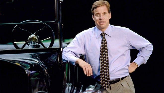 Bill Ford Jr., chairman of the Ford Motor, stands next to a Model T in Dearborn, Mich., in this 1999 file photo.