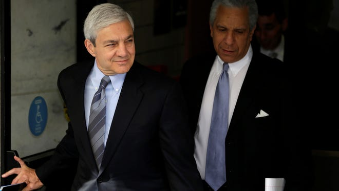 Former Penn State president Graham Spanier, left, faces charges in the child sex-abuse scandal involving former assistant football coach Jerry Sandusky.