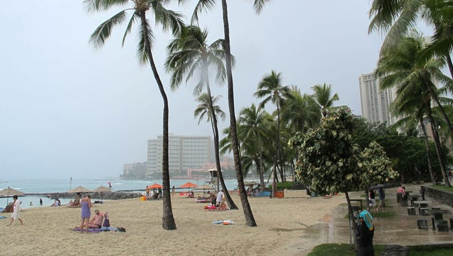 Few people visited Waikiki beach in Honolulu on Monday as Tropical Storm Flossie approached Hawaii.