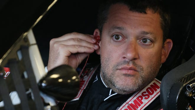 Tony Stewart sits in his car during practice for the Samuel Deeds 400 at the Indianapolis Motor Speedway.