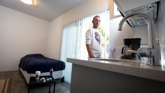 Joe Rose, a 27-year-old college student, lives in a 190-square-foot apartment in Seattle.