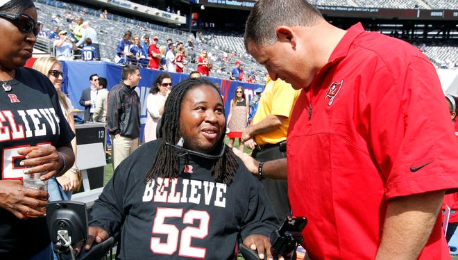 Eric LeGrand  talk with Tampa Bay Buccaneers head coach Greg Schiano before a game.
