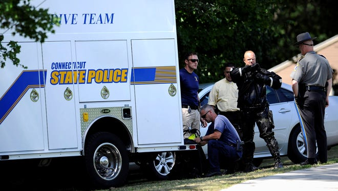 Connecticut State Police searched Pine Lake in Bristol, Conn., for a second consecutive day July 30. They are looking for evidence in the investigation of Aaron Hernandez.
