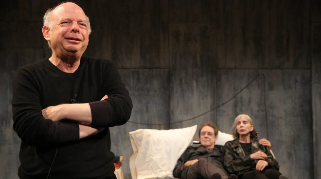 Wallace Shawn, left, Larry Pine and Deborah Eisenberg perform in a scene from the off-Broadway play 'The Designated Mourner.'