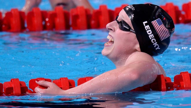 Katie Ledecky of the United States celebrates after winning the gold medal in the women's 1500 freestyle final at the FINA Swimming World Championships in Barcelona Tuesday.