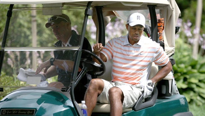 Tiger Woods shows up for practice at Oak Hill Country Club in Pittsford, N.Y. on Tuesday.