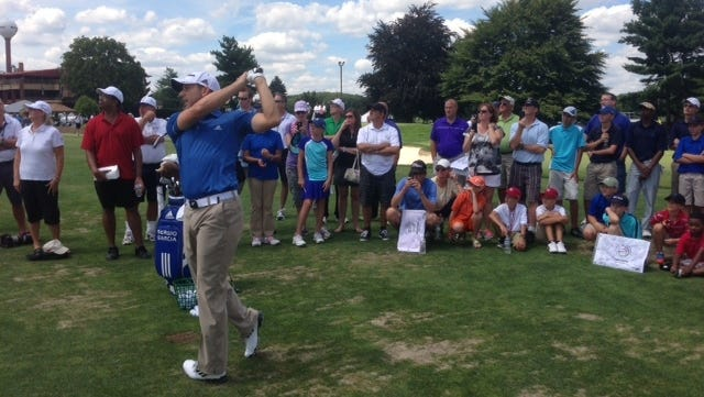 Sergio Garcia hits shots and answers questions on Tuesday at Firestone Country Club.