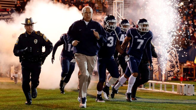 Connecticut coach Paul Pasqualoni, shown leading his team onto Rentschler Field last Nov. 9, is one of the many voices in the American Athletic Conference who recognize the heightened stakes of this being the final season the league's members can earn an automatic BCS bid.