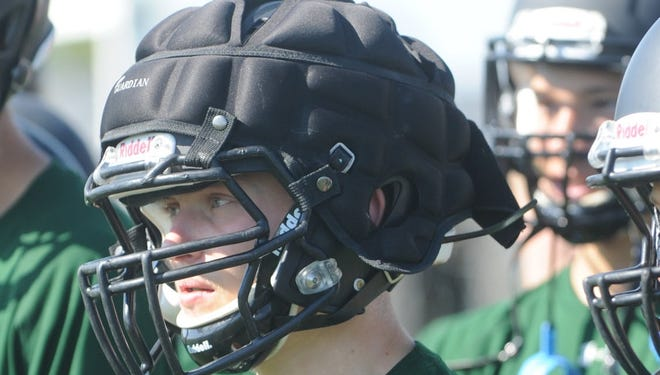 Fossil Ridge High School (Ft. Collins, Colo.) sophomore running back, Chase Jolly wears a Guardian Cap on his helmet at practice July 26.