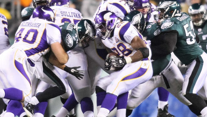 Vikings RB Adrian Peterson (28) can lower his head near the line of scrimmage but not when he's running downfield.