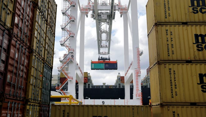 A crane removes a container from a ship at the Port of Baltimore's Seagirt Marine Terminal in Baltimore.