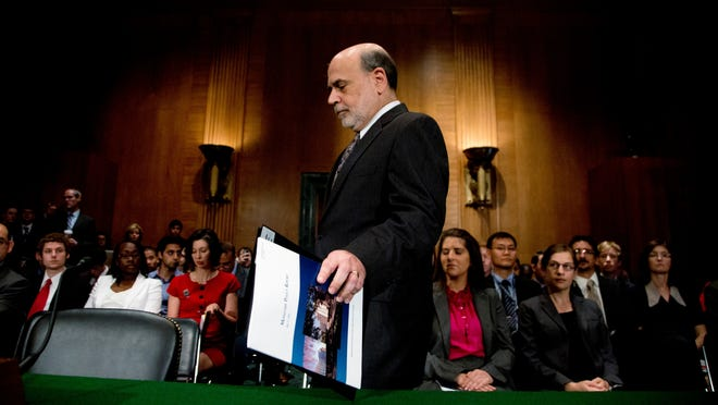 In this July 18, 2013, file photo, Federal Reserve Chairman Ben Bernanke arrives to testify before a Senate banking committee.
