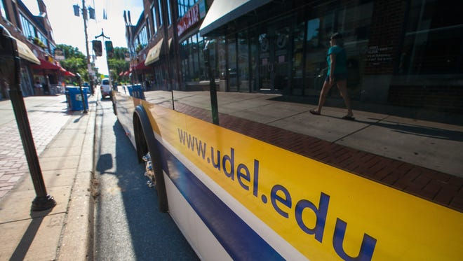 University of Delaware bus is parked along Main Street in Newark, Del.  A recent cyber attack on the University of Delaware website compromised confidential information for more than 72,000 current and former employees.