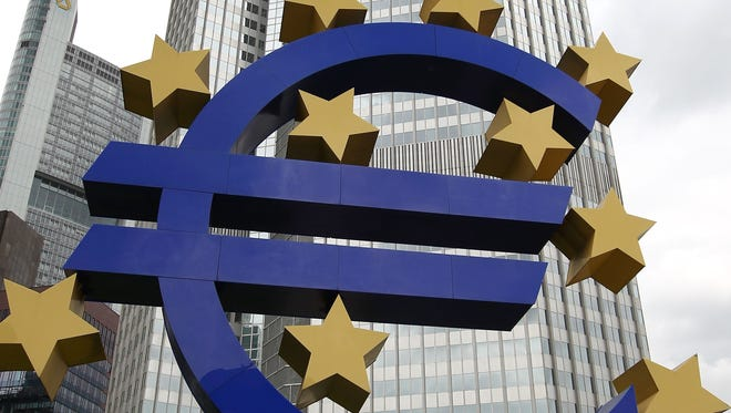 The Euro logo is seen in front of the European Central Bank (ECB) building. Jobless rates in the 17 euro-using countries fell for the first time in two years.