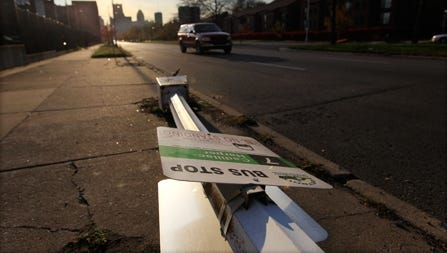 A broken streetlight lies on a sidewalk east of downtown Detroit. Some city leaders say Michigan bears some of the blame for Detroit's decline.