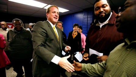 """Iowa Gov. Chet Culver, a Democrat, greets local residents after signing the Minority Impact Statement Bill in 2008. Supporters say racial impact statements could curb the spread of """"stand your ground"""" laws and certain voter registration legislation."""