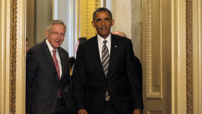 President  Obama and Senate Majority Leader Harry Reid arrive for a meeting with Senate Democrats on Capitol Hill on July 31.