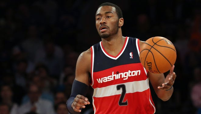 John Wall will stick with the Wizards for five more years.