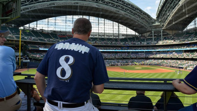 Bryan Von Declan shows his disappointment for Milwaukee Brewers left fielder Ryan Braun (not pictured) by taping over the name on the back of a jersey at Miller Park after Braun was suspended last week for the season for violating MLB drug policies.