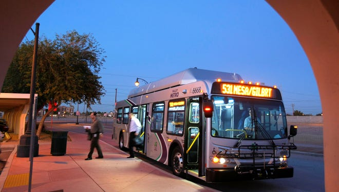 Passengers disembark a Valley Metro bus at the Gilbert Park-and-Ride Tuesday, Jan. 31, 2012 in Gilbert, Ariz.