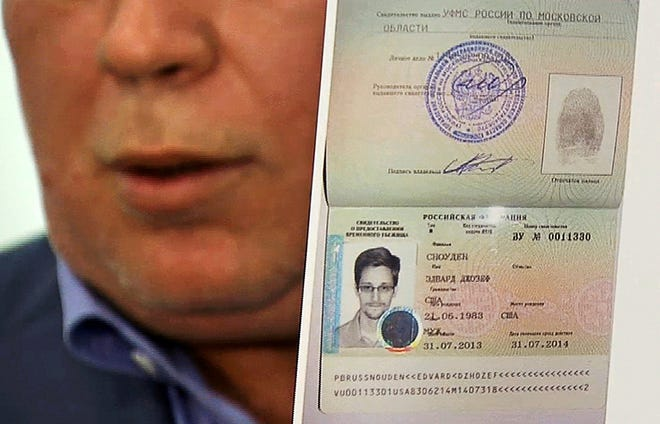 Russian lawyer Anatoly Kucherena on Thursday displays a temporary document to allow NSA leaker Edward Snowden to cross the border into Russia.