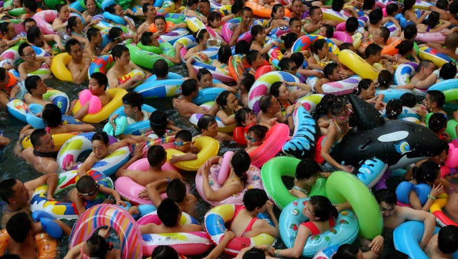People try to cool off at a water park in Suining, China, last weekend, as a heat wave hit several provinces in China.