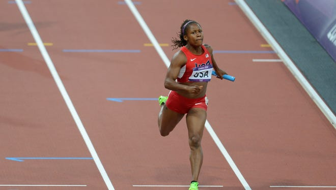 In a file photo from Aug. 9, 2012, Lauryn Williams crosses the finish line during the women's 4x100 relay heats during the London  Games.