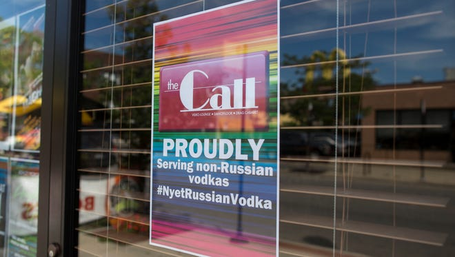 A sign outside of The Call, a gay bar on the north side of Chicago, Monday.  Many gay bars have joined a campaign to stop selling Russian vodka due to anti-gay laws in Russia.