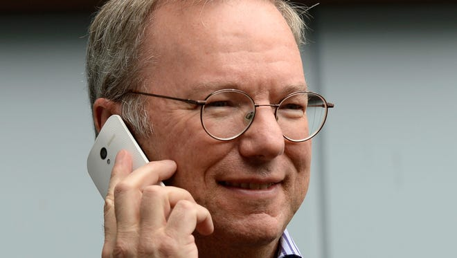 Eric Schmidt, executive chairman of Google, makes a call on the Moto X phone during the Allen & Co. annual conference in July in Sun Valley, Idaho.