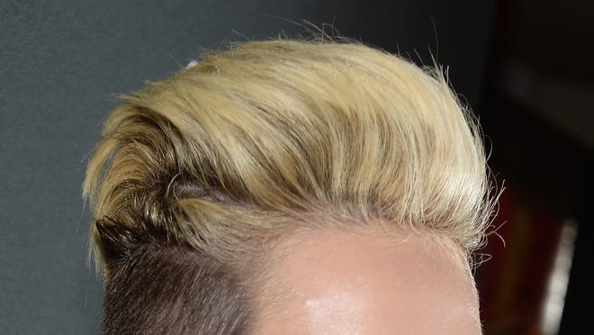 Miley Cyrus shows off her do at the New Myspace launch event on June 12 in Los Angeles.