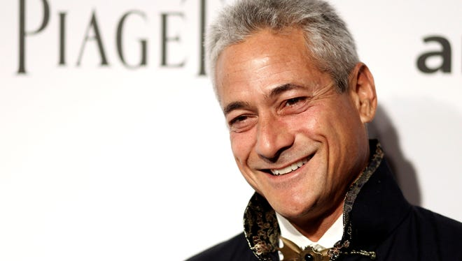 In this Oct. 27, 2011 file photo, Olympic diving champion Greg Louganis arrives at amfAR's Inspiration Gala in Los Angeles.