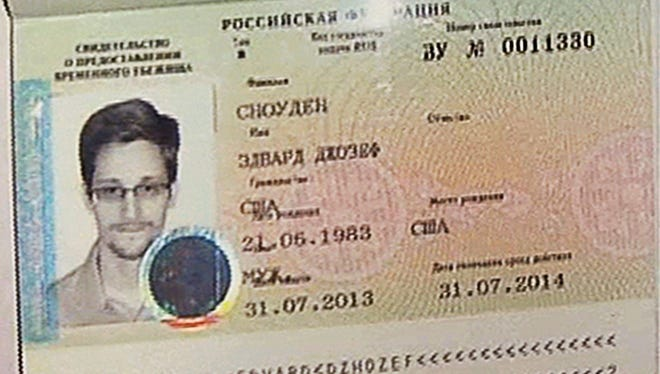 This is a copy of a temporary document that allows Edward Snowden to cross the border into Russia. It was issued to Snowden on Thursday.