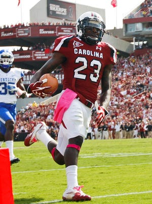 South Carolina Gamecocks wide receiver Bruce Ellington (23) scores a touchdown in the fourth quarter of the game against the Kentucky Wildcats at Williams-Brice Stadium.