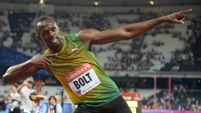 Usain Bolt poses after winning the 100m in 9.85 in the Sainsbury's Anniversary Games at Olympic Stadium on July 26.