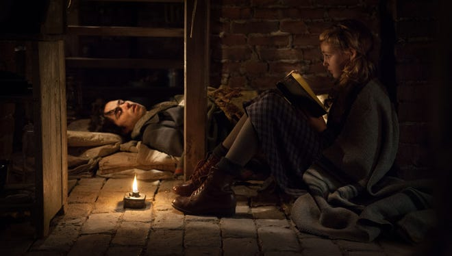 "Ben Schnetzer and Sophie Nélisse in a scene from the motion picture ""The Book Thief."""