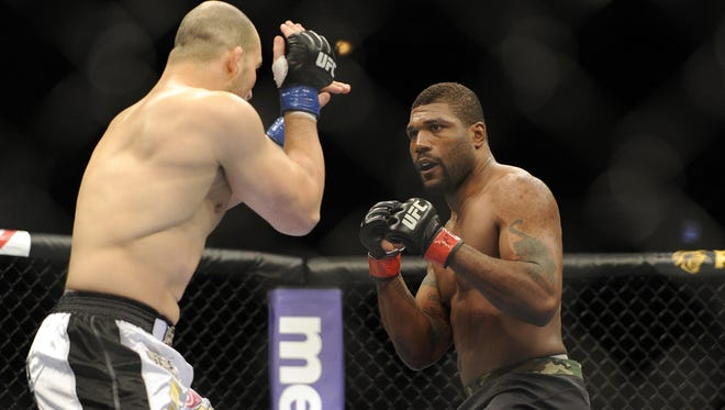 Rampage Jackson, right,  fights Glover Teixeira during UFC on FOX 6 in Chicago. Jackson will fight Tito Ortiz Nov. 2 on pay-per-view