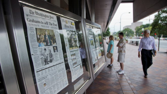 The front page of the Washington Post is displayed outside the Newseum in Washington, Tuesday, Aug. 6, 2013, a day after it was announced that Amazon.com founder Jeff Bezos bought the Washington Post for $250 million.