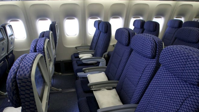 Premium economy can offer extra comfort for much less than business class, but fliers need to pay close attention as airlines' offerings differ greatly.