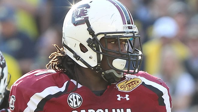 South Carolina defensive end Jadeveon Clowney (7) is one of many prominent NCAA athletes whose replica jerseys -- displaying their numbers, not names -- could be found Tuesday by searching for their names on an NCAA-branded e-commerce site.