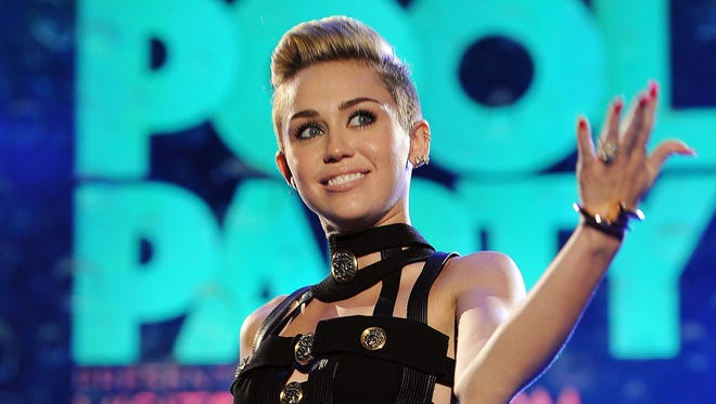Miley Cyrus hosts the iHeartRadio Ultimate Pool Party in Miami. She announced the title of her album Monday.