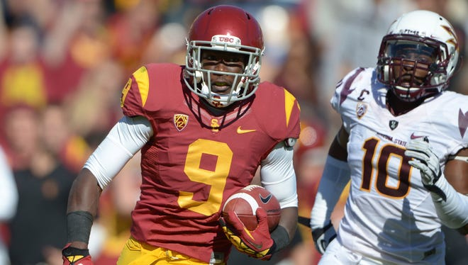 Southern California receiver Marqise Lee (9) is pursued by Arizona State safety Keelan Johnson (10) on an 80-yard touchdown reception last November, says he signed autographs for no pay during a visit to the site of the BCS championship in January.