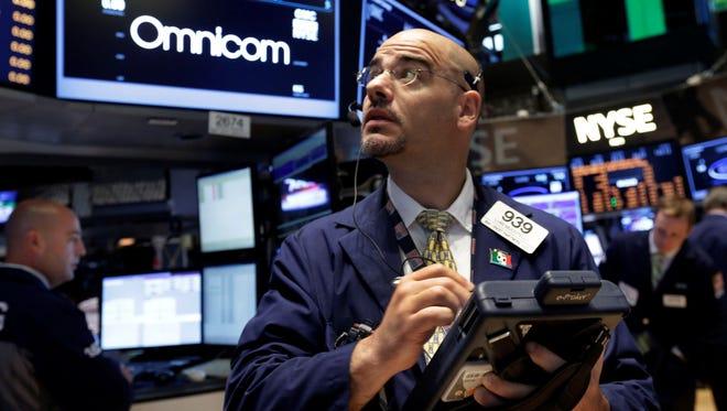 Trader Luigi Muccitelli works on the floor of the New York Stock Exchange.