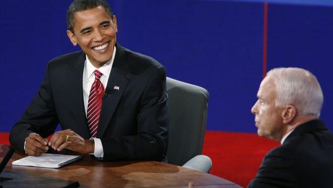 Barack Obama and John McCain at a debate in 2008