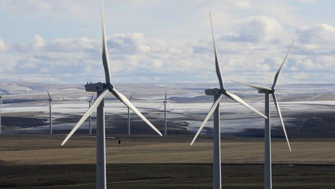 Windmills dot the horizon at a wind farm in Oregon.