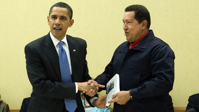 President Obama and Hugo Chavez shake hands at a 2009 summit.